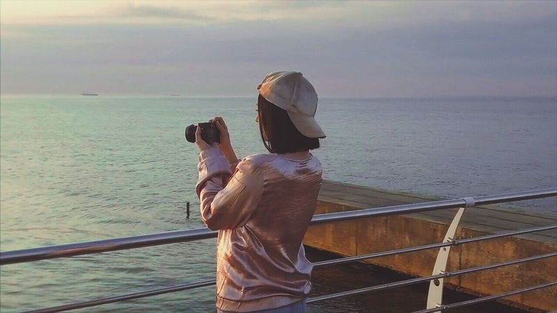 Sea Water Real People Rear View Horizon Over Water Railing Nature Two People Scenics Leisure Activity Lifestyles Standing Outdoors Men Sky Day Togetherness Beauty In Nature Women Tranquil Scene Camera Digital Camera Photography Videoshoot Teenager