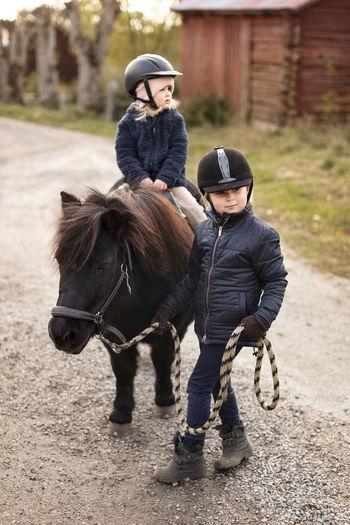 Men riding horse