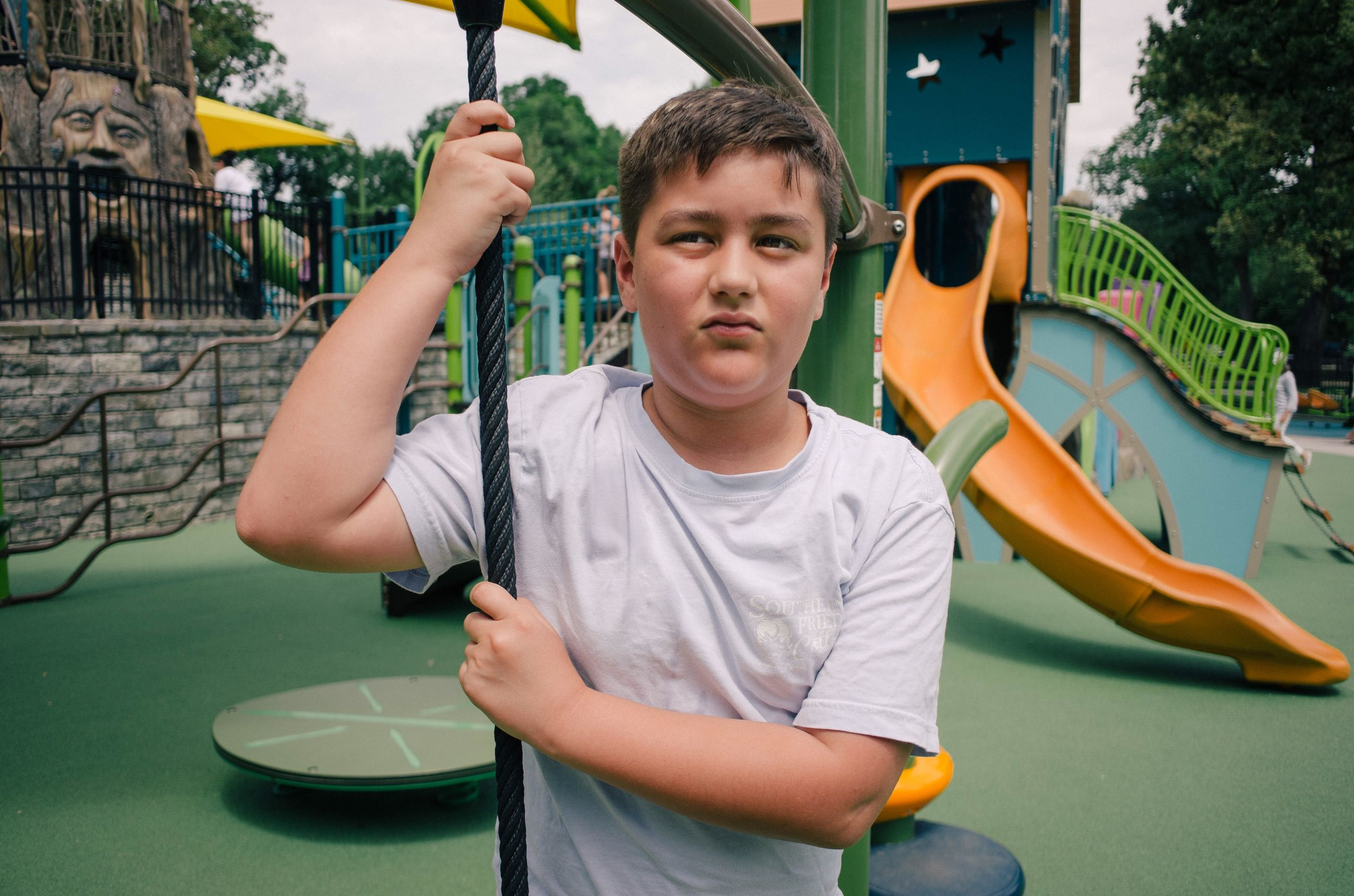 one person, real people, boys, child, front view, leisure activity, childhood, lifestyles, men, males, casual clothing, portrait, waist up, day, holding, playing, looking at camera, innocence, outdoor play equipment
