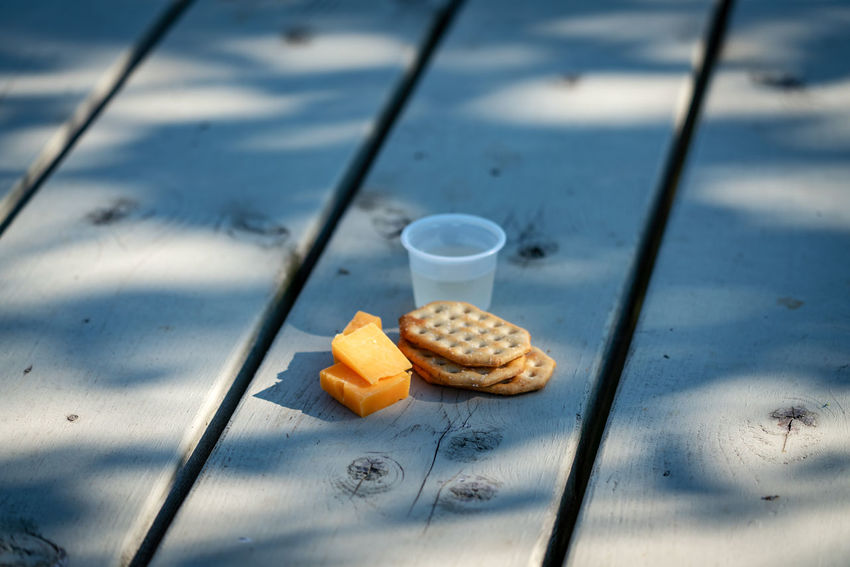 Partner Collection The EyeEm Collection Vine Tasting Food And Drink Food No People Day Wood - Material Still Life High Angle View Outdoors Freshness Sunlight Drink Close-up Nature Healthy Eating Table Wellbeing Shadow Focus On Foreground Snack Temptation Vine Cheese Cracker Food And Drink Cup Refreshment Freshness