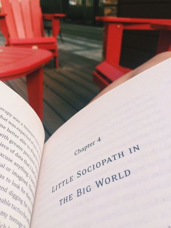 TakeoverContrast Red White Chairs Book Sociopath Text Open Close-up Focus On Foreground No People Tranquility Calm Outdoors Reading Big World Small Space Maximum Closeness Always Be Cozy