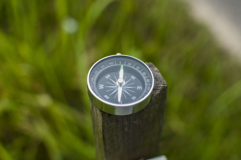 Close-up of navigational compass on wood