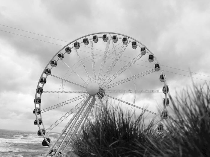 EyeEm Selects Amusement Park Sky Arts Culture And Entertainment Amusement Park Ride Ferris Wheel Outdoors No People Cloud - Sky Nature