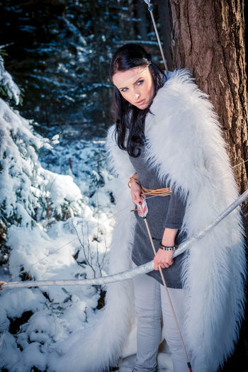 female elf with a bow in the wintry forest Amazon, Arms, Army, Arrow, Attractive, Beautiful, Beauty, Bow, Elf, Fantasy, Female, Film, Forest, Girl, Hobbit, Hunter, Indigenous, Nature, Outdoors, People, Person, Sexy, Strength, Weapon, Winter, Wintry, Woman One Person Tree Snow Cold Temperature Winter Young Adult Land Outdoors