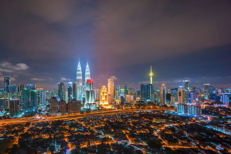 Kuala Lumpur city skyline at dusk blue hour Architecture Building Exterior Business Business Finance And Industry City Cityscape My Year My View Cultures Development Downtown District Financial District  Futuristic Growth Highway Illuminated Modern Night Prosperity Road Skyscraper Speed Tower Traffic Travel Destinations Urban Skyline