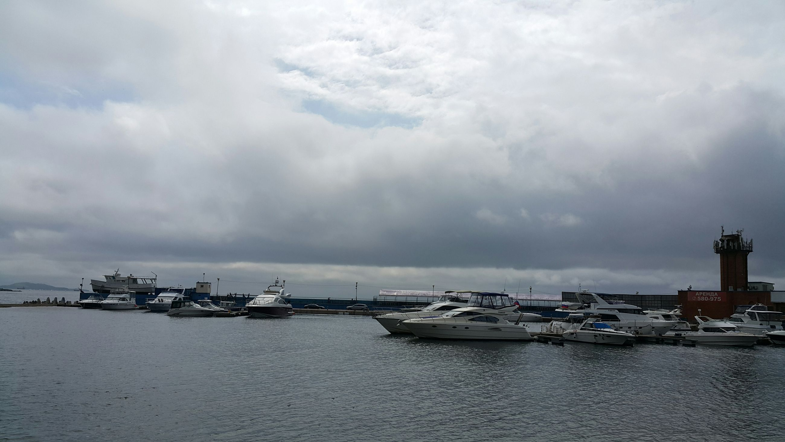 water, sky, sea, nautical vessel, cloud - sky, transportation, mode of transport, cloudy, moored, waterfront, boat, weather, harbor, built structure, overcast, building exterior, architecture, nature, tranquility, cloud