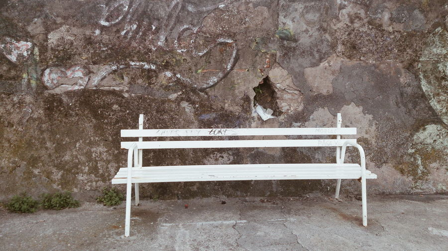 Close-up of empty seat against trees