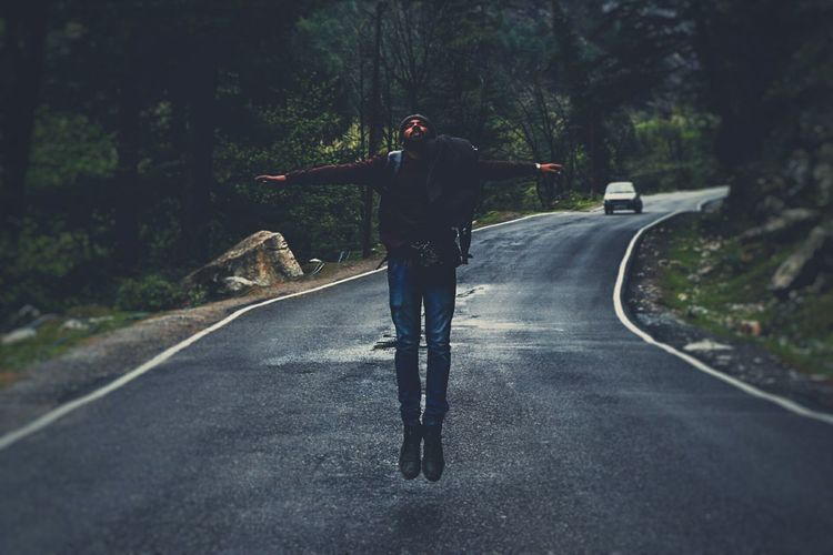 Man On Road Along Trees