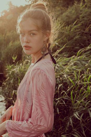 Side view of teenage girl standing on field