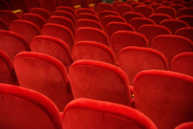 Erve Erve Miozzo Photo Miozzo Red Arrangement Auditorium Backgrounds Chair Day Empty Film Industry Full Frame In A Row Indoors  Movie Theater No People Red Red Color Seat