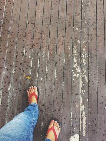Low Section Human Leg Shoe Human Foot Personal Perspective Human Body Part Standing One Person High Angle View Real People Jeans Outdoors Day Sandal Lifestyles Directly Above Sidewalk People Adult Close-up