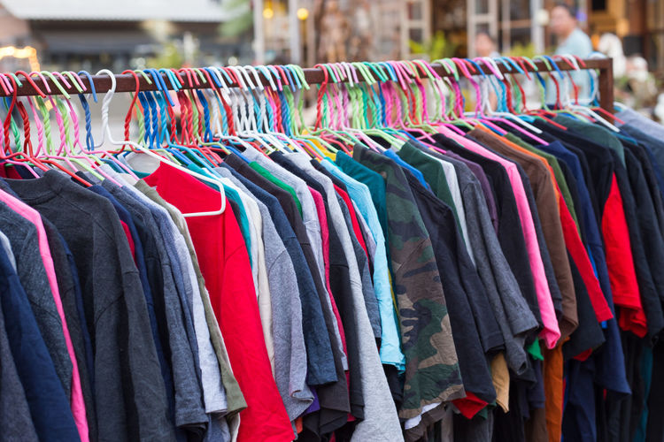 Various color of T-shirt on rack Hanging Out Indy Man Market Second Acts Cloth Colorful Cucasian Hang Man Suite Market Stall Rack Shirt Useed Variation Wear