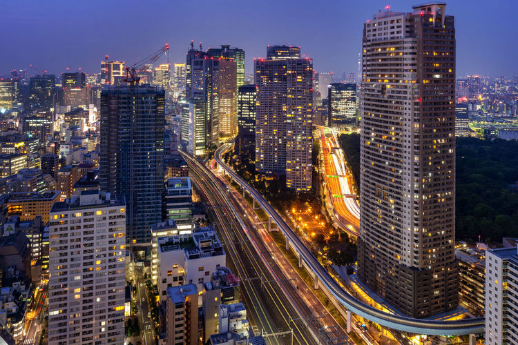 Tokyo cityscape and traffic at night. Architecture Building Building Exterior Built Structure City City Life Cityscape Crowd Downtown District Financial District  High Angle View Illuminated Landscape Modern Office Building Exterior Outdoors Sky Skyscraper Tall - High Tower Transportation Travel Destinations Urban Skyline
