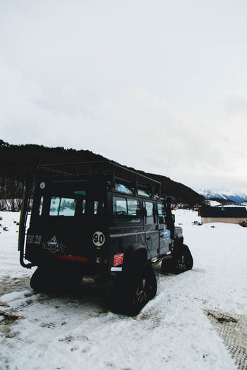Beauty In Nature Car Cloud - Sky Cold Temperature Day Field Land Land Vehicle Landscape Mode Of Transportation Motor Vehicle Mountain Nature No People Outdoors Sky Snow Snowcapped Mountain Transportation Travel Winter