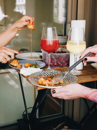 Friends eating Shashlik Germany Rainy Day Girls Eating Evening Party Cosy Human Hand Holding Women Healthy Lifestyle Close-up Food And Drink Serving Tongs Chopsticks Grilled Barbecue Grilled Chicken