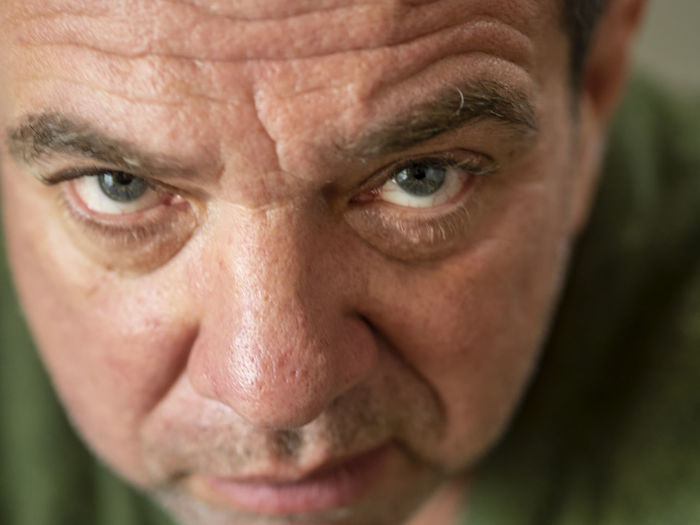 Close-up portrait of angry mature man