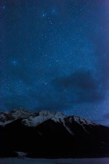 Mountain and stars Scenics - Nature Night Star - Space Sky Astronomy Beauty In Nature Snow Cold Temperature Space Mountain Winter Tranquil Scene Tranquility Nature Star Mountain Range Snowcapped Mountain Star Field Mountain Peak Astrophotography Canada Outdoors Travel Landscape