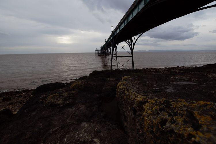 Clevedon Pier Water Sky Sea Cloud - Sky Horizon Over Water Horizon Rock Scenics - Nature Rock - Object Nature Beauty In Nature Tranquil Scene Solid Land No People Tranquility Beach Built Structure Idyllic Outdoors Rocky Coastline Beach Architecture