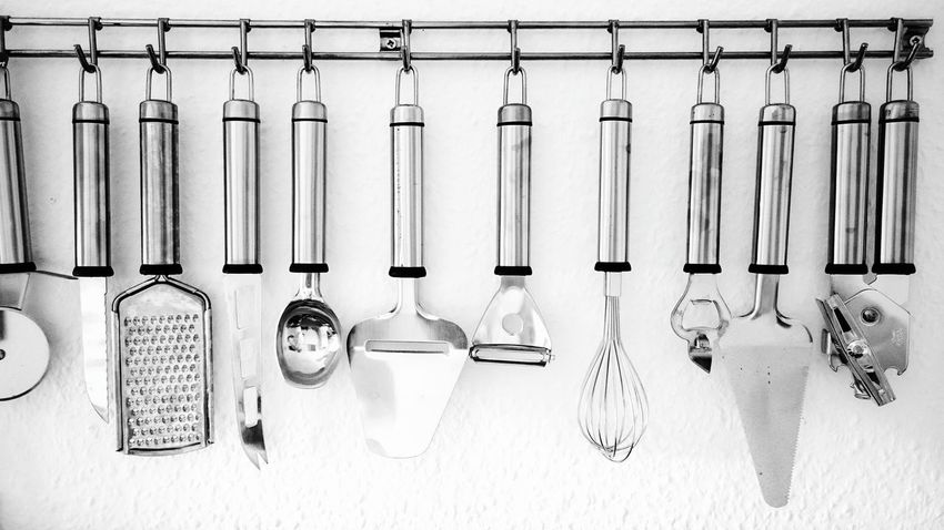 Beautifully Organized Neat Kitchen Utensil Preparation  Wire Whisk Hanging In A Row No People Indoors  Cooking Utensil Large Group Of Objects Colander Organized Blackandwhite Black And White