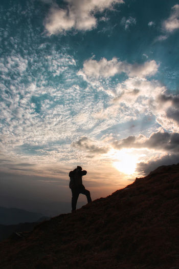 Doing what I do best. #aesthetic #himalayas #Himachal #Wanderer #Nature  #Incredible India #EyeEmNewHere #PrasharLake #travel Photography Themes Full Length Sunset Mountain Adventure Photographing Standing Photographer Silhouette Rocky Mountains Hiker Cloudscape