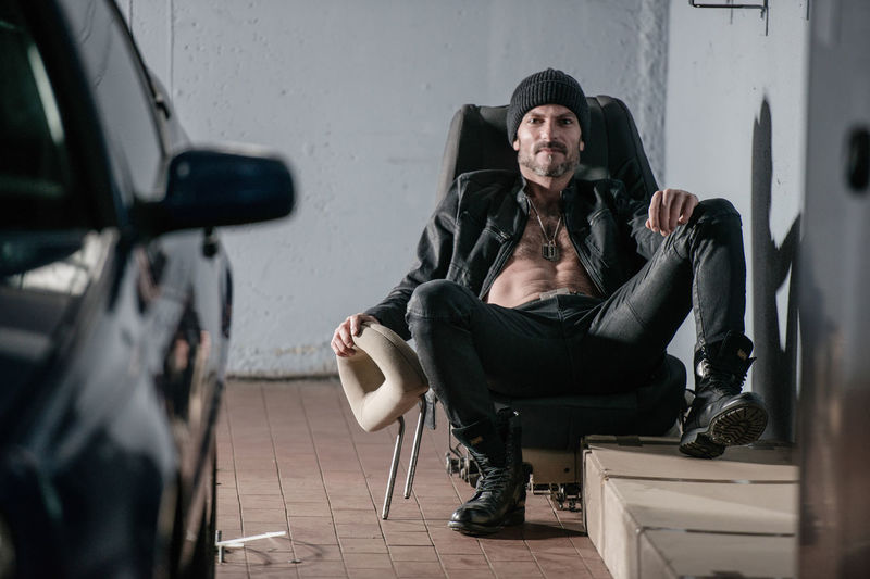 Sitting Full Length One Person Men Mode Of Transportation Transportation Lifestyles Adult Real People Young Adult Casual Clothing Front View Seat Motor Vehicle Chair Car Portrait Service Station Lifestyle Photography Model Emotion