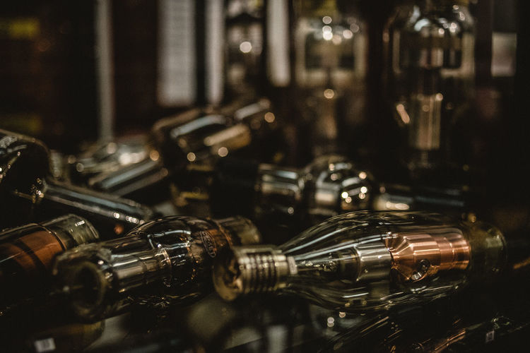Close-up Selective Focus Metal Focus On Foreground No People Still Life Indoors  Large Group Of Objects Container Glass - Material Bolt Table In A Row Bullet Transparent Nut - Fastener Day Safety Refreshment EyeEmNewHere EyeEm Best Shots
