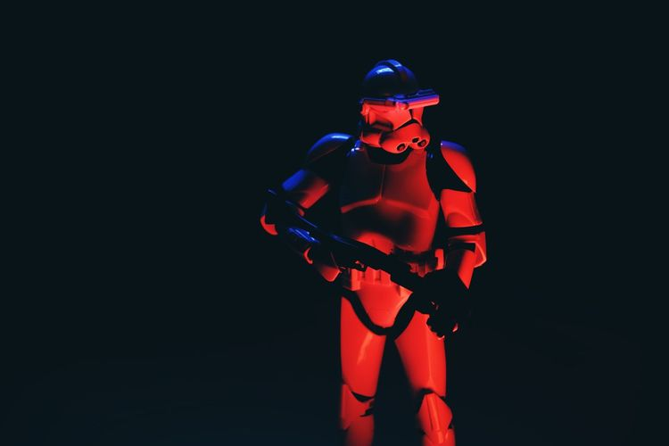 Studio Shot Black Background Indoors  One Person Three Quarter Length Illuminated Front View Red Copy Space Standing Futuristic Cut Out Human Representation Representation Robot Young Adult Technology Clothing Holding Star Wars Clone Trooper Clonetrooper Light Painting Star - Space Hobby Toys Scale Model Scale Model Photography
