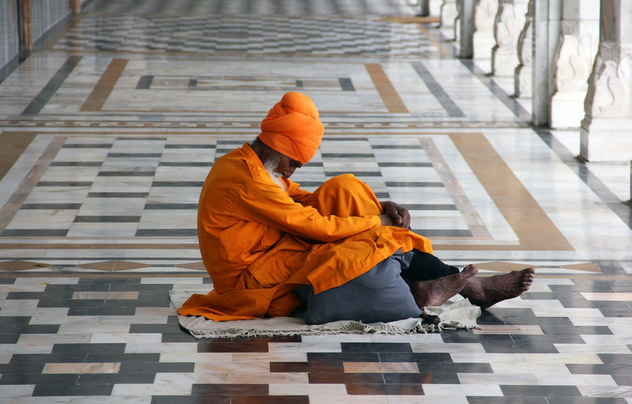 At the Gurudwara Bangla Sahib in Delhi. Adult Color Portrait Colors EyeEm Best Shots EyeEm Gallery Full Frame Full Length India Indian Culture  Meditation Only Men Outdoors People Praying Religion Sikh Temple Temple - Building Travel Travel Destinations Travel Photography Worship The Street Photographer - 2017 EyeEm Awards This Is Masculinity