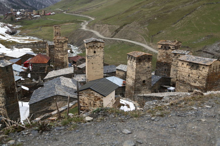 Georgia Mestia/town In Svaneti/Georgia Built Structure Architecture Building Exterior Building Nature Land Day No People House Field Outdoors Plant Environment Landscape Village Solid Tree High Angle View Grass Ruined