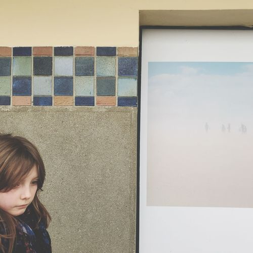 Girl by wall