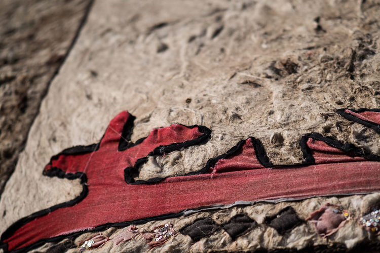 Red No People Close-up Day Land Nature Art And Craft Outdoors Solid Creativity Selective Focus High Angle View Focus On Foreground Textured  Rock Rock - Object Animal Pattern Animal Themes Old Ornaments Kyrgyzstan Pamir Yurt