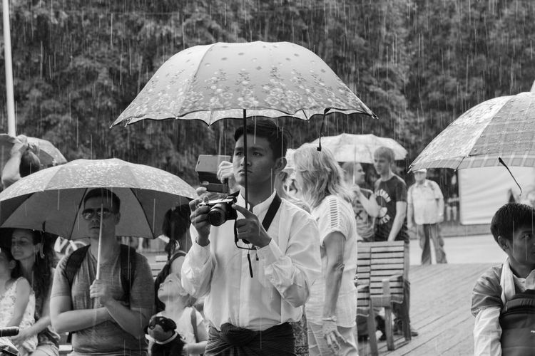 Indonesian guys in the rain Adult Crowd Day Focus On Foreground Group Of People Leisure Activity Lifestyles Men Nature Outdoors People Protection Rain Rainy Season Real People Security Umbrella Wet Women