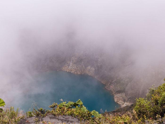 Smoke emitting from volcanic mountain
