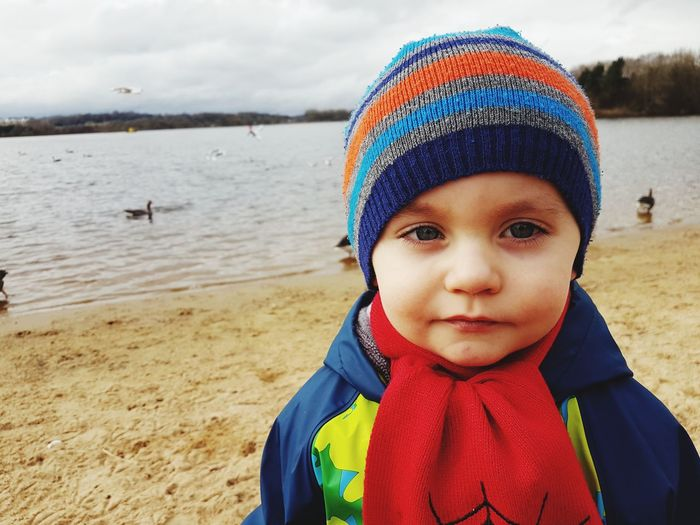 Child Knit Hat Children Only Childhood Lifestyles Multi Colored One Person Sea People Baby Close-up Warm Clothing Portrait Beach Outdoors Sky Day