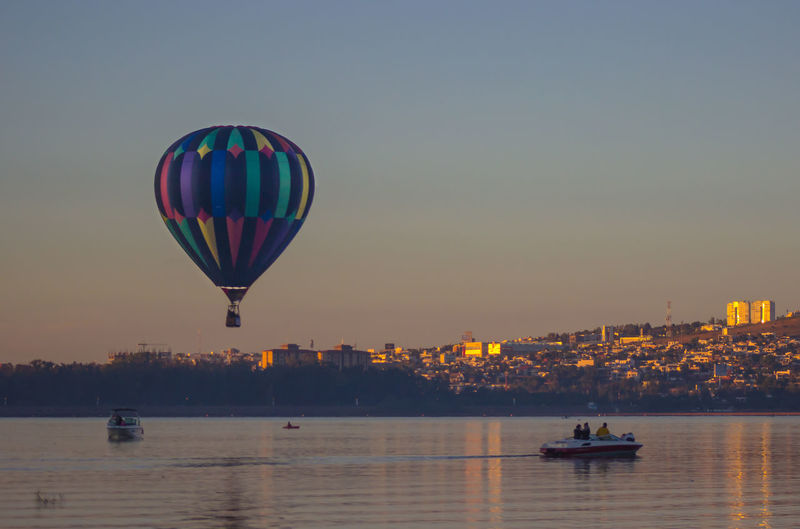 Hot Air Balloon Flying Sunset Sky Outdoors No People Day
