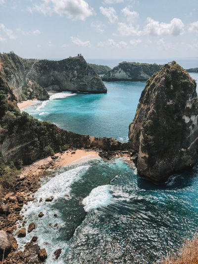 Atuh beach in Nusa Penida Rock Water Sky Scenics - Nature Rock - Object Beauty In Nature Sea Tranquility Nature Rock Formation Tranquil Scene No People Day Land Mountain Idyllic Non-urban Scene Outdoors Power In Nature Flowing Water Atuh Beach Nusa Penida Bali Blue Ocean