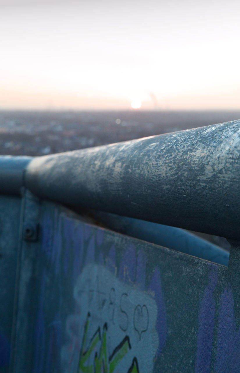metal, outdoors, close-up, sunset, no people, day, built structure, nature, architecture, sky