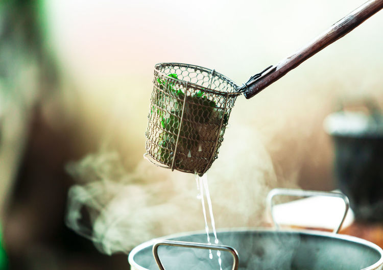 Food In Container Over Hot Kitchen Utensil