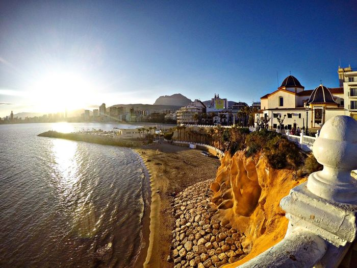 Just another beautiful day at Benidorn, Spain Architecture Building Exterior Built Structure Water Sunlight Sun Clear Sky Sea Sunny Blue Waterfront Sunbeam Day Shore Outdoors Nature Town Residential District Lens Flare Harbor