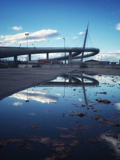 Bridge over water against blue sky