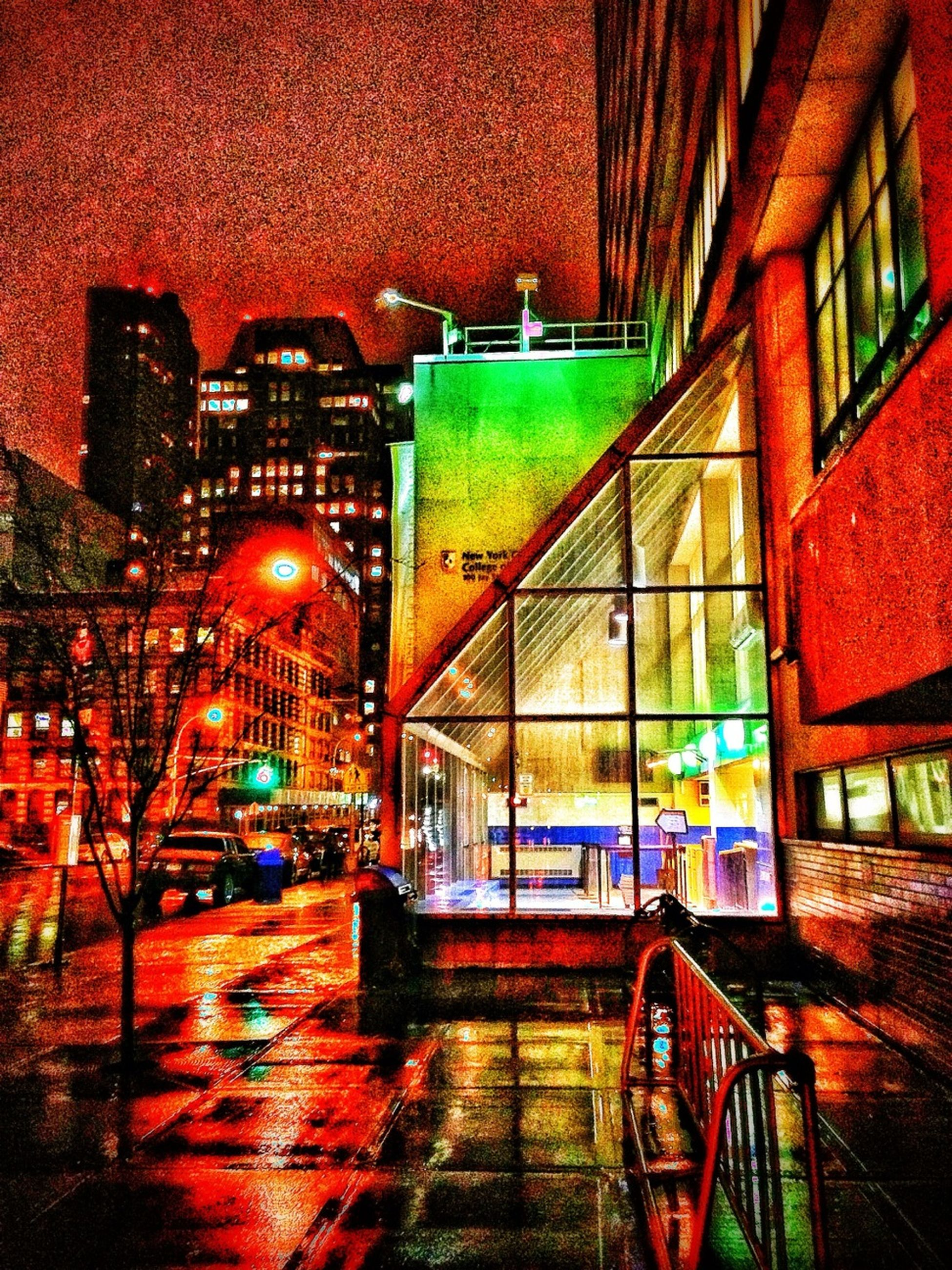 architecture, built structure, building exterior, transportation, mode of transport, multi colored, red, illuminated, bicycle, wall - building feature, land vehicle, street, railing, indoors, steps, no people, night, window, high angle view
