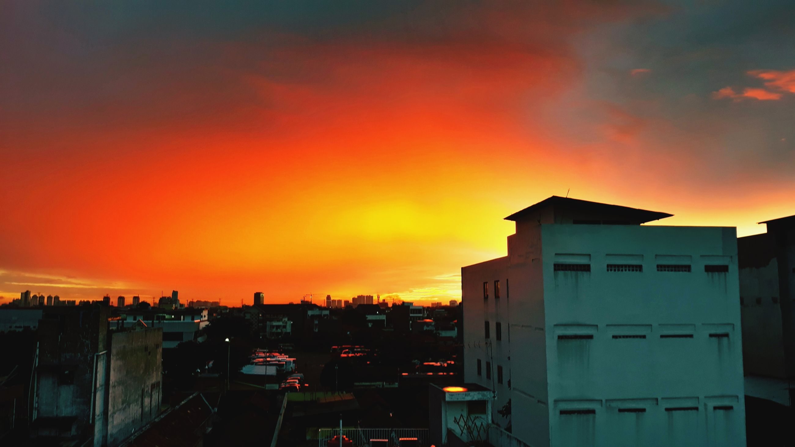 sunset, building exterior, built structure, orange color, architecture, sky, silhouette, outdoors, no people, cloud - sky, nature, beauty in nature, city