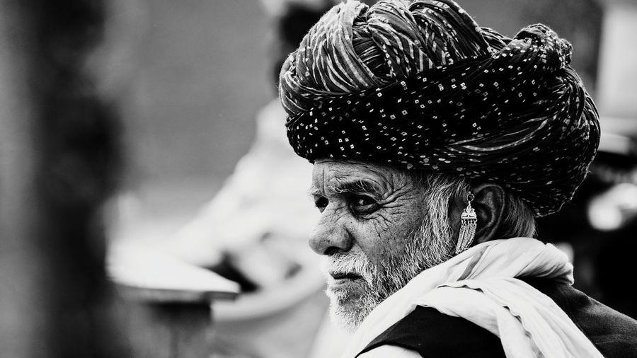 Close-up of man wearing turban looking away