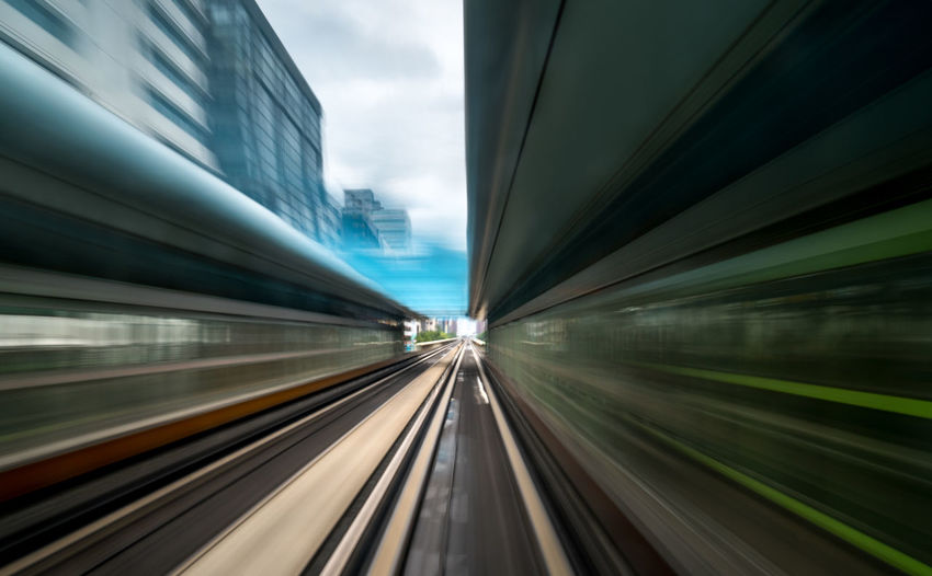 Blurred motion of train against building