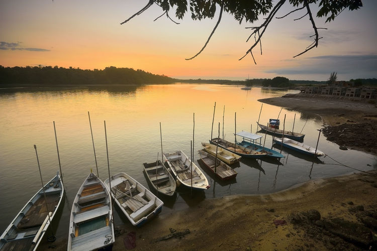 High Angle View Of Boats Moored On Lake During Sunset