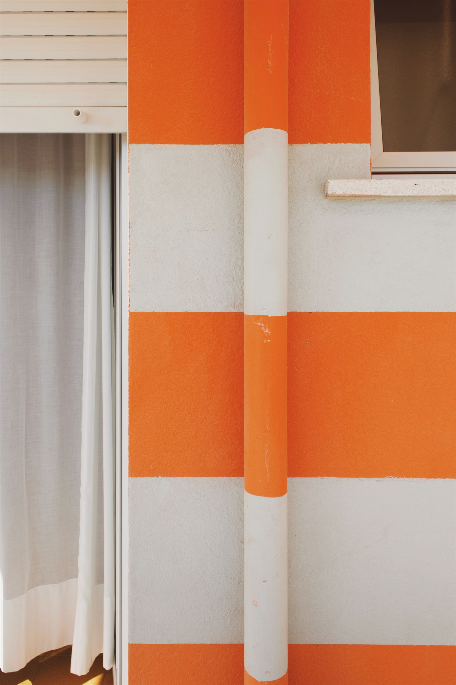 orange color, full frame, backgrounds, wall - building feature, no people, white color, close-up, architecture, built structure, pattern, multi colored, red, indoors, day, striped, window, wall, white
