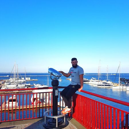Nautical Vessel Casual Clothing Clear Sky Blue Leisure Activity Copy Space Water Day Park Bench Sitting Mode Of Transport Sea Person Summer