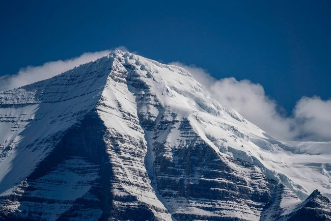 Mt Robson - Tallest Peak in Canadian Rocky Mountains EyeEm Selects Snow Winter Mountain Cold Temperature Sky Snowcapped Mountain Scenics - Nature Beauty In Nature Cloud - Sky Nature Environment Tranquil Scene Mountain Range Landscape Blue Mountain Peak Tranquility No People