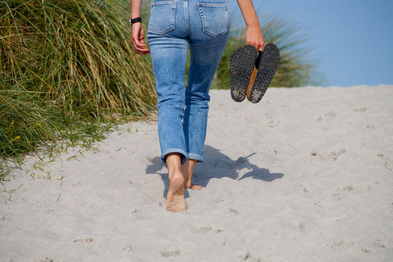 People Beach Nature Real People Men Walking Women Rear View Shadow Day Outdoors Jeans Sand Vacations Adult Adults Only Lifestyles Young Adult EyeEm Ready   One Person Young Women Casual Clothing Leisure Activity Human Leg Low Section Human Body Part Fashion Stories Standing
