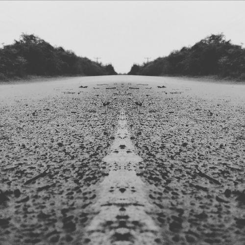 long road ahead Road Roadways Water Lake Sky Rainy Season Weather Wet Empty Road
